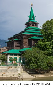 Riverside view of Shah E-Hamdan Mosque in Srinagar, Jammu and Kashmir, India.