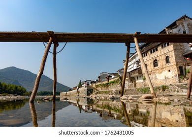 A riverside village and ancient bridge in moutains of South China