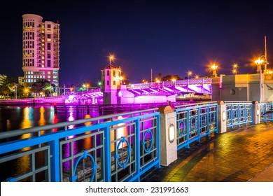 The Riverwalk and bridge over the Hillsborough River at night in Tampa, Florida.