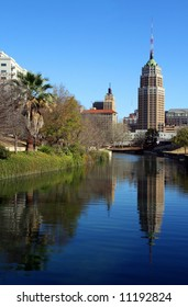 a riverwalk reflection of a tower in the San Antonio skyline