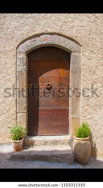 riveted old wooden door entrance