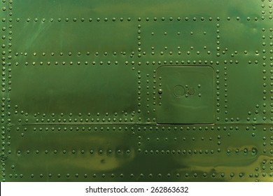 Rivets and Metal Background Dark Green Painted. Metal Military Grade Backdrop