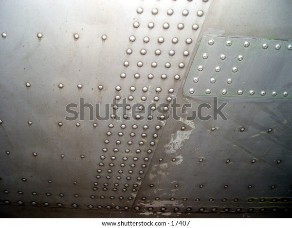 Rivets under a planes wing