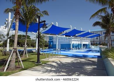 RIVIERA BEACH MARINA VILLAGE, FLORIDA - JULY 27: A beautiful blue sun shade and interactive fountain for children, on July 27, 2016, in Riviera Beach, Florida, at the new Marina Village complex.