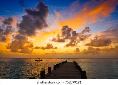 Riviera Maya pier sunrise in Caribbean Mayan Mexico