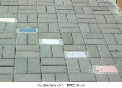 Rivne, Ukraine - 08 May 2020: Sidewalk paved with broken iphones. Paving tiles and old mobile phones in it
