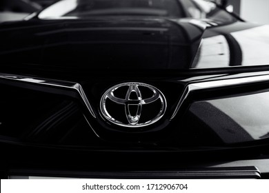RIVNE, UKRAINE - OCTOBER 27, 2019: Close up of Toyota car logo on a black Toyota car. Toyota Motor Corporation is a Japanese automotive manufacturer headquartered in Toyota, Aichi, Japan.