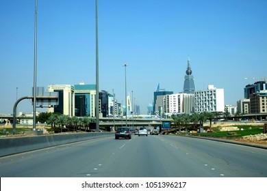 Riyadh, Kingdom of Saudi Arabia - March 7, 2018: Cars approaching Cairo Square Intersection via King Fahad Road in the capital of KSA