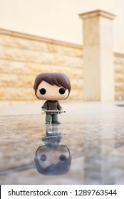 Riyadh, KSA - April 7, 2017: Game of Thrones Character Arya Stark portrayed Maise Williams by Funko Pop Vinyl Toys  with her sword called needle standing of a marble surface by a pillar