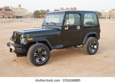 Riyadh - Saudi Arabia - 10-01-2020: 1995 Jeep Wrangler Sahara off-road with a background