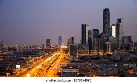 Riyadh, Saudi Arabia – December 18th 2020: Riyadh City and King Abdullah Financial District aerial view. Main road King Fahd Road appears. twilight time.