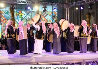 Riyadh, Saudi Arabia - December, 26 2018: Saudi men singing and dancing in Al-Jenadriyah, a cultural and heritage festival held in the capital