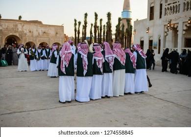 Riyadh, Saudi Arabia – December 29th 2018: Janadriah Festival. A group of men perform a traditional Saudi Arabian dance and singing.