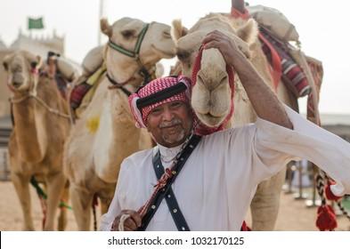 Riyadh, Saudi Arabia – February 16th 2018: Janadriah Festival. A man with his camels