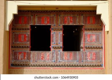 Riyadh, Saudi Arabia - February 19, 2018: Intricate old Najd style patterns adorn this restaurant exterior in Al Bujairi square in Diriyah district