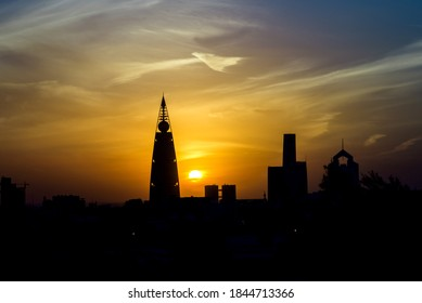 Riyadh / Saudi Arabia - February 4, 2017: A beautiful golden sunset beside the famous tower in the city