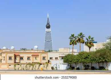 RIYADH, SAUDI ARABIA - FEBRUARY 9, 2015: Al Faisaliyah Tower Center in Riyadh with some palm trees
