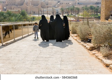 Riyadh, Saudi Arabia, January 11th, 2017: A group of muslim women and  a boy visiting at historic buildings in Dariyah clay castle, also as Dereyeh and Dariyya, a town in Riyadh, Saudi Arabia