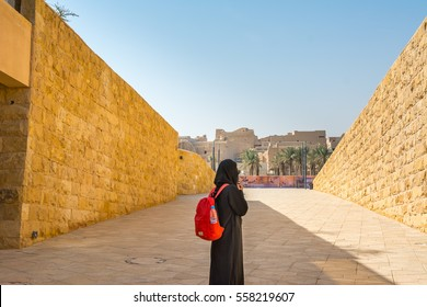 Riyadh, Saudi Arabia, January 12, 2017, A woman wearing black hijab watching ruins of Diraiyah, also as Dereyeh and Dariyya, a town in Riyadh, Saudi Arabia