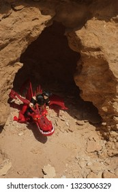 Riyadh, Saudi Arabia - January 18, 2019: How to Tame Your Dragon character Snotlout Jorgenson rides his dragon Hookfang  and both emerge from a cave.