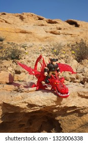 Riyadh, Saudi Arabia - January 18, 2019: How to Train Your Dragon character Snotlout Jorgenson rides  his dragon in the called Hookfang, a Monstrous Nightmare class.