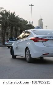 Riyadh, Saudi Arabia - June, 30 2018: A shot of taxi cab in King Fahd main road in the Saudi capital.