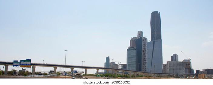 Riyadh, Saudi Arabia, KSA - August 24, 2021 new buildings in the King Abdullah Financial District with train metro bridge in Riyadh