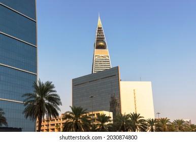 Riyadh, Saudi Arabia, KSA - August 25, 2021 Al Faisaliah Tower Skyscraper with palm trees in Riyadh