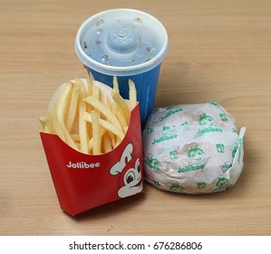 Riyadh, Saudi Arabia - March 16, 2017: Philippine's Popular Fast Food Jollibee's Yum Meal consists of French Fries, Burger and Cola and sold in International branches