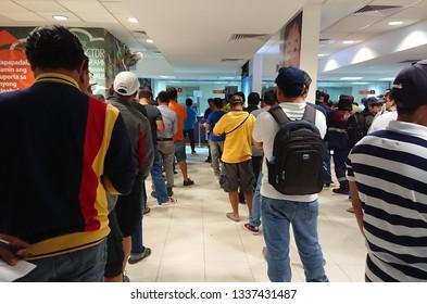 Riyadh / Saudi Arabia - November 27, 2018 : People are waiting in line to remit money via a money transfer service