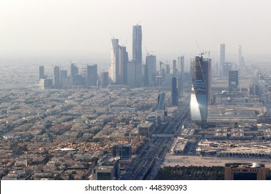 RIYADH, SAUDI ARABIA - OCTOBER 15, 2015. Zoom skyline view at King Abdullah Financial District from the top of Riyadh Kingdom tower in foggy cloudy day