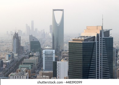 RIYADH, SAUDI ARABIA - OCTOBER 15, 2015. Zoom skyline view at Riyadh Kingdom tower and other skyscrapers in background in cloudy foggy day, from the top of Al Faisaliah tower