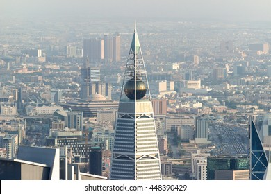 RIYADH, SAUDI ARABIA - OCTOBER 15, 2015. Zoom skyline view at Al Faisaliah tower and other skyscrapers in background in cloudy foggy day, from the top of Riyadh Kingdom tower