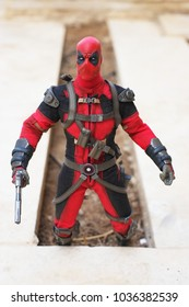 Riyadh, Saudi Arabia-February 26, 2018: Action figure of Deadpool or Wade Winston Wilson which is a fictional character from Xmen and Avengers published by Marvel comics