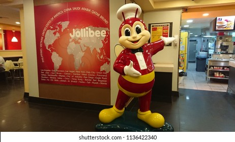 Riyadh/Saudi Arabia - June 18, 2018: A mascot statue of Jollibee restaurant welcomes customers at its branch in KSA. This popular Filipino Fast Food chain has opened many franchises around the world.
