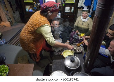 RIZE, TURKEY - AUGUST, 06, 2013: The villager woman is cooking traditional food in the Black Sea and Turkey.