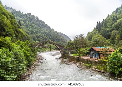 RIZE, TURKEY - AUGUST 15, 2016 : General landscape view of historical high stone bridges on Firtina river in Rize Camlihemsin area on foggy sky background.
