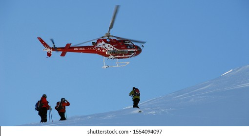 Rize, Turkey, October, 2019: Snowboarders and skiers on top of the Mountain with Heli Ski. Rize is the hub for Heli-skiing in Turkey. Heli Skiing Helicopter.