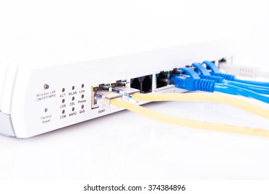 RJ45 connected to a router on white background