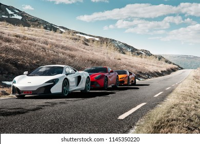 Rjukan, Norway. 04.06.2016: White Mclaren 650s, Red Ferrari f12 and Yellow Lamborghini Huracan