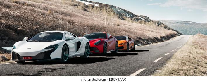 Rjukan, Norway. 04.06.2016: White Mclaren 650s, Red Ferrari f12 and Yellow Lamborghini Huracan