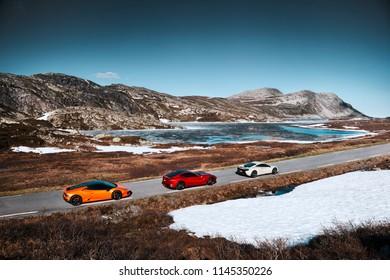 Rjukan, Norway. 04.06.2016: Yellow Lamborghini Huracan, Red Ferrari f12 and white Mclaren 650s