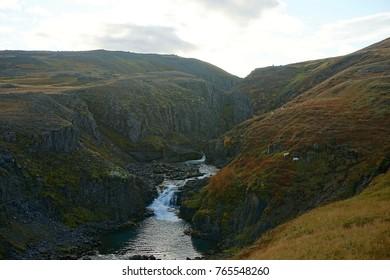 Rjukandi falls in valley near Egilsstadir