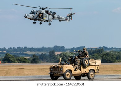 RNAS YEOVILTON, ENGLAND - July 07, 2018: A Wildcat AH1 helicopter performing at the Yeovilton International Air Day as part of the Helicopter Force Role Demo at RNAS Yeovilton, England