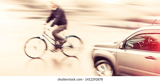 Road accident. Dangerous city traffic situation with a cyclist and cars in motion blur and color shift