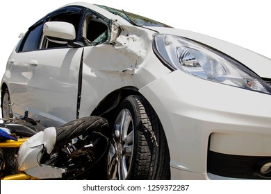 Road accidents : Close up of damage, broken glass caused by motorcycle collision, side impact, white front wheel.