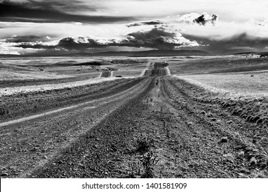 Road across the hills and plains of Patagonia, Argentina. Black and white