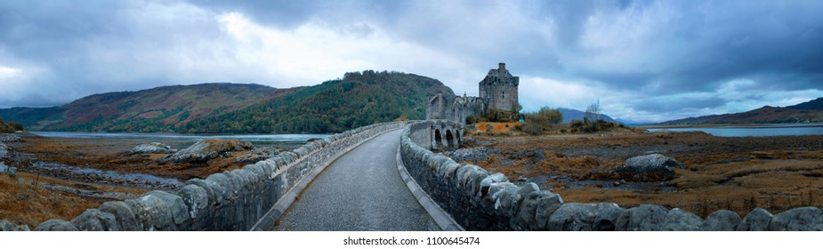 The road across Loch Duich to Eilean Donan Castle in the Highlands of Scotland. Blue hour panorama in autumn.