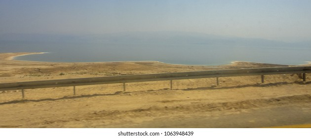 Road along the Dead Sea. Route 90 in Israel between the cities of Jerusalem and Ein Bokek. Middle East. View from bus