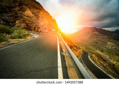Road along the mountains in the beautiful sunset view in autumn time.